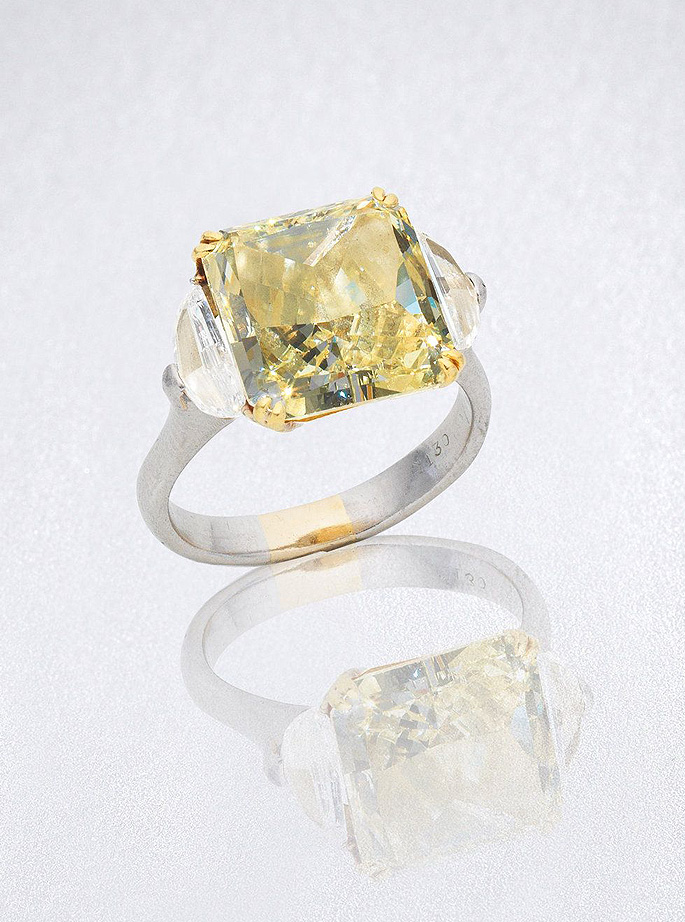 A fancy yellow coloured diamond and diamond ring
