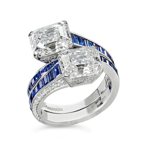 A 3.18ct and 3.04ct emerald-cut diamond and calibre sapphire cross over ring set in platinum £120,000