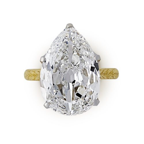 A 4.42ct old-cut pear shape diamond solitaire ring with engraved gold band £60,000