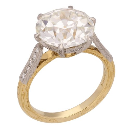 A 5.95 carat old-cut diamond solitaire ring with diamond-set shoulders £99,500